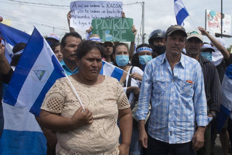 """""""La determinación de luchar contra la apropiación de la tierra y un régimen autoritario. Foto : La Prensa."""
