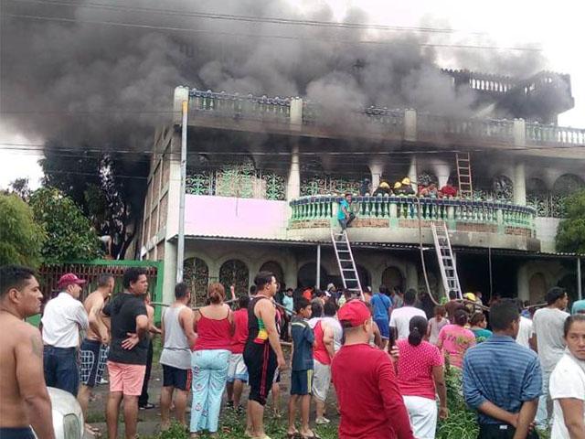 Fachada de la casa en la que fueron quemado vivos seis miembros de una familia. Foto: Tomada de Internet